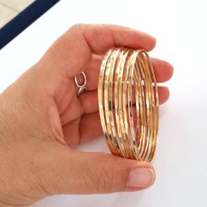 Set of 4 - Delicate 14k Gold Filled Wire. Hammered Bangles