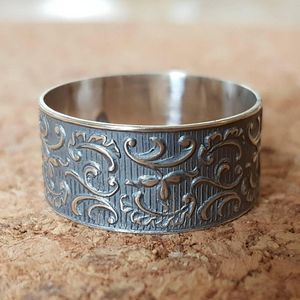 Wide silver wedding ring, flower and leaf pattern, women's wedding band, textured silver base, raised yellow gold edges, art nouveau design
