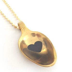 Unique golden teaspoon pendant with a black heart and a resin coat,  vintage style.