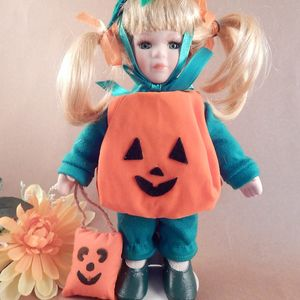 """Doll Pumpkin Halloween Costume Blonde Girl Porcelain with Stand 9"""" Keepsake Collectible Display Doll Fall Home Decor"""