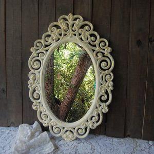 Ornate ivory mirror